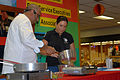 Guest Chef Andre Halson Checks the Temperature of a Hot Plate During a Food Demonstration at Naval Station Guantanamo Bay DVIDS228145.jpg