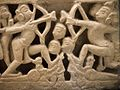 Hanuman Carrying the Mountain of Medicinal Herbs (left); Rama Battles Ravana (right), Architectural Panel with Ramayana (Adventures of Rama) Scenes LACMA M.89.159.1 (3 of 6).jpg