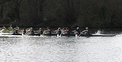 Oxford women (dark blue) lead Cambridge women at the 2009 Henley Boat Race.