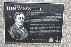 Photo of Henry Fawcett and Millicent Fawcett black plaque