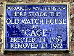 "Here stood the old watch house or ""cage"". erected in 1765 removed in 1912"