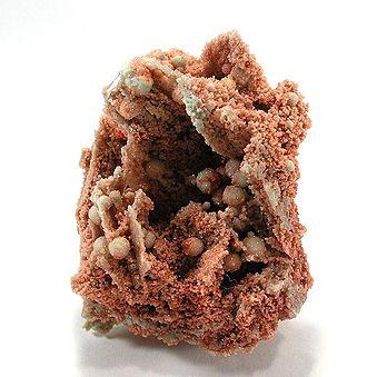 Hilgardite - Microcrystalline red-orange hilgardite encasing white boracite, from Boulby Mine, Loftus, North Yorkshire, England. Size: 5.5 × 4.5 × 3.4 cm.