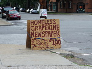 Homeless Grapevine - A sign advertising the Homeless Grapevine at Lincoln Park, Tremont