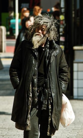 Poverty in Japan - A homeless man in Shibuya, Tokyo