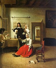 Woman drinking with two men and a maid in an interior