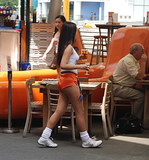 Waiting staff - A Hooters waitress in Singapore, 2008