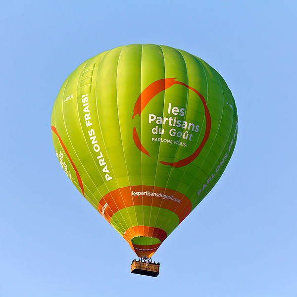"Hot air balloon over Bondues - registration F-HMIG with advertising for ""Les partisans du goût"""