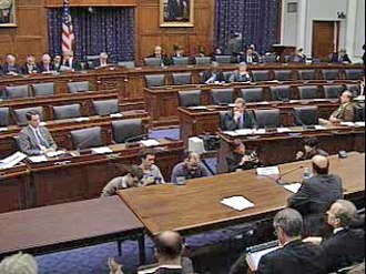Federal Reserve System - Ben Bernanke (lower-right), Former Chairman of the Federal Reserve Board of Governors, at a House Financial Services Committee hearing on February 10, 2009. Members of the Board frequently testify before congressional committees such as this one. The Senate equivalent of the House Financial Services Committee is the Senate Committee on Banking, Housing, and Urban Affairs.