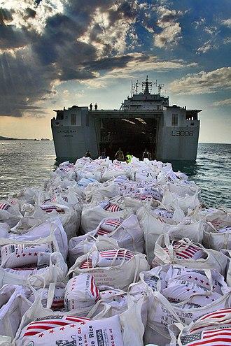 HMAS Choules (L100) - Humanitarian supplies being unloaded from Largs Bay at Haiti