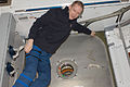 ISS-21 Frank De Winne at the Harmony node nadir hatch during HTV-1 unberth preparations.jpg