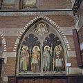 Interieur, overzicht van een muurschildering van vier Heiligen in het noorder transept - 's-Gravenhage - 20380046 - RCE.jpg