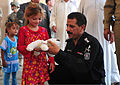 Iraqi Col. Muhammed Mahdi, right, an Iraqi Police chief, hands a gift to a young resident of the village of Yethrib, during an event celebrating Eid al-Fitr on Contingency Operating Base Warhorses, Iraq, Aug 110831-A-MI957-004.jpg