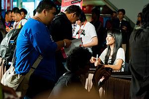 JKT48 - A JKT48 member greets fans at an autograph event.