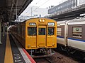 JRW 105 series set K09 at Hiroshima Station (23169815799).jpg