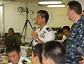 Japan Maritime Self-Defense Force (JMSDF) Cmdr. Kiyoshi Asano, center, discusses staff planning on the JMSDF helicopter destroyer JDS Hyuga (DDH 181) during Dawn Blitz 2013 at Naval Base San Diego, Calif 130607-M-JU912-020.jpg