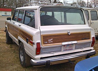 Jeep Wagoneer (SJ) - 1984 to 1991 Grand Wagoneer tail-lights no longer wrapped around the rear corners, but used the type from the SJ-body Cherokee – narrow and vertical on the tailgate panel only