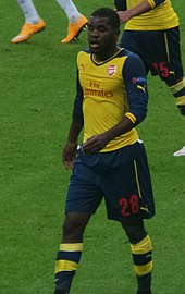 A colour photograph of Joel Campbell, in action for Arsenal in a Premier League game.
