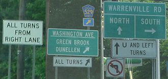 Jughandle - Examples of signage at jughandles on New Jersey state highways.