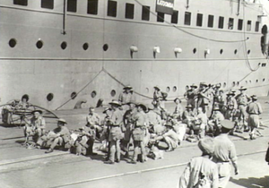 SS Columbia (1913) - Troops of the 2nd AIF en route from the Middle East to Australia, waiting to embark on the transport Katoomba at Bombay 25 March 1942.