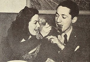 Kitty Kallen and Leonard Feather swap Armenian vittles, 1945.jpg