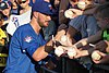 Kris Bryant signing autographs during his rehab assignment against Omaha (29379025027).jpg