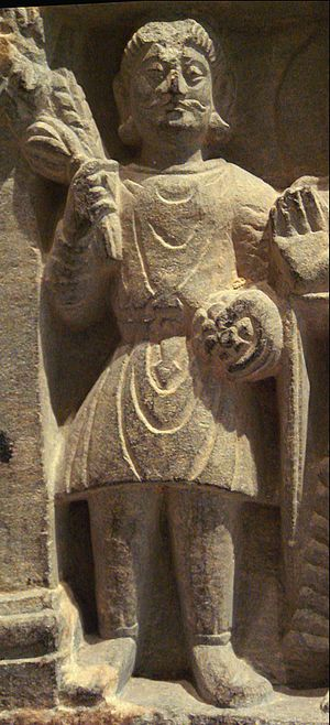 "Kushan Empire - A Buddhist devotee in Kushan dress, Mathura, 2nd century. The Kushan dress is generally depicted as quite stiff, and it is thought it was often made of leather (Francine Tissot, ""Gandhara"")."