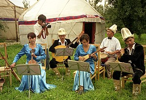 Music of Kyrgyzstan - A group of Kyrgyz musicians performing in a yurt camp in Karakol