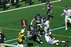 Lindenwood Lions - Quarterback, David Ortega, dives toward the goal line in a game against Kansas Wesleyan.