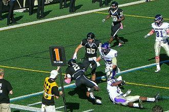 Lindenwood Lions - Quarterback, David Ortega, dives toward the goal line in a game against Kansas Wesleyan.