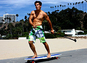 Longboard (skateboard) - Land paddling with the Kahuna Creations Kahuna Stick.