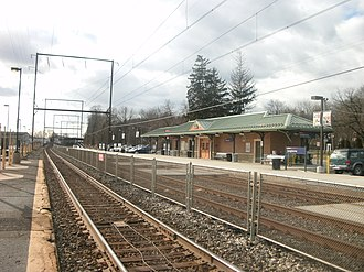 Langhorne station - The station at Langhorne in February 2012 from the abandoned outbound platform. The new station depot, constructed in 2010, is visible on the inbound platform.