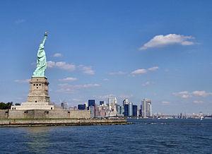 Statue against Manhattan (similar images).
