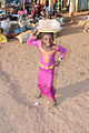 Little girl with a bowl on her head the Gambia.jpg