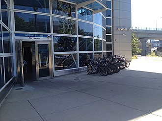 Airport station (MBTA) - Bremen Street entrance with bicycle parking