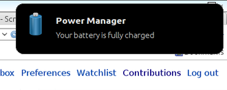 Pop-up notification - Close-up of the upper right corner of a Lubuntu 12.04 desktop, showing a notification that informs the user that the battery has finished charging.