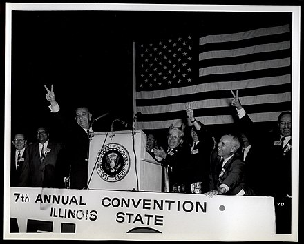 President Lyndon Johnson (left), alongside Illinois AFL-CIO President Reuben Soderstrom (center) and Vice President Stanley Johnson (right), speaks to the delegates of the 1964 Illinois AFL-CIO convention. Lyndon Johnson at the 1964 Illinois AFL-CIO Convention.jpg