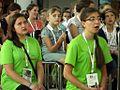 Młodzi ludzie podczas uroczystej mszy św. (9528505369).jpg