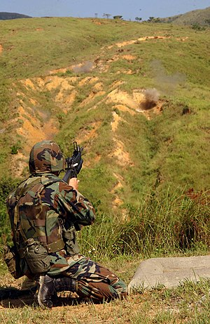 40 mm grenade - M203 qualification range: a 40×46mm training round can be seen hitting the hill.