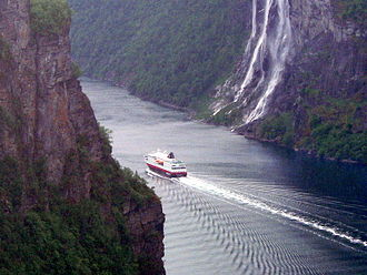 Hurtigruten AS - MS Kong Harald (coastal express) in Geirangerfjord.