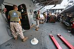 Mail call, U.S. Marines and Sailors sort packages 150815-M-TJ275-038.jpg