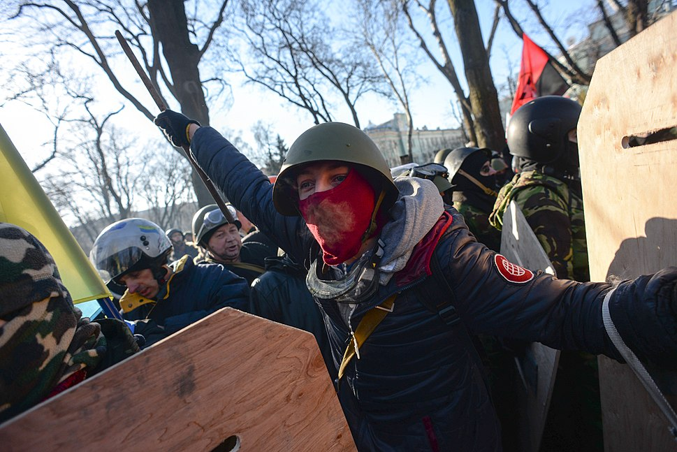 Maked protester seen during clashes in Kyiv, Ukraine. Events of February 18, 2014