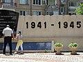 Man and Child with World War Two Memorial - Vratsa - Bulgaria (41171252990).jpg
