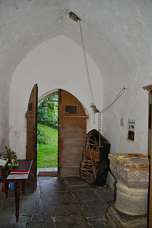 Manordeifi Old Church - Church interior, showing the coracle kept in the porch