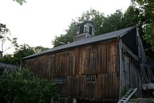 The image is of a wooden barn