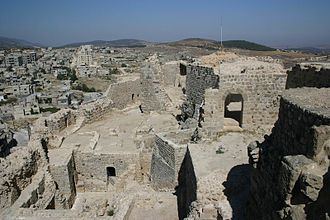 Masyaf - A view of part of the fortress (foreground) and the modern city of Masyaf (background), 2004
