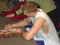 Forward Matt Bonner signing autographs prior to a game.