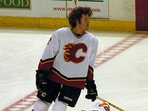 Mike Commodore - Mike Commodore of the Calgary Flames skates in a pre-game warm-up during the 2003-04 season