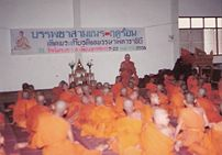 The abbot of a Buddhist monastery instructing novices, Uttaradit, Thailand.