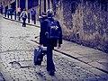 Musician walking up Niddry Street during the 2014 Festival.jpg