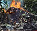 My Tho, Vietnam. A Viet Cong base camp being. In the foreground is Private First Class Raymond Rumpa, St Paul, Minnesota - NARA - 530621.jpg
